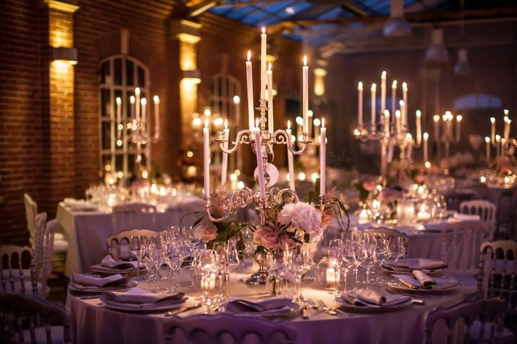 Candelabra and flowers for a stunning wedding setting in a greenhouse in Bologna