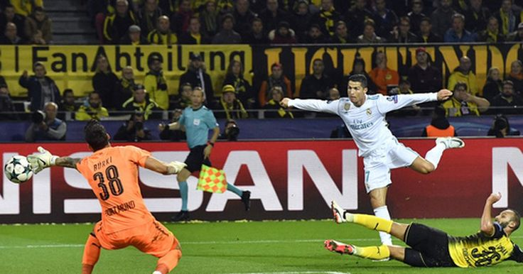 DORTMUND, Germany (AP)  A brace from Cristiano Ronaldo helped two-time defending champion Real Madrid to a 3-1 win at Borussia Dortmund in the Champions League on Tuesday.   Ronaldo, yet to score in the Spanish league where he sat out a five-game suspension for shoving a referee, took his...