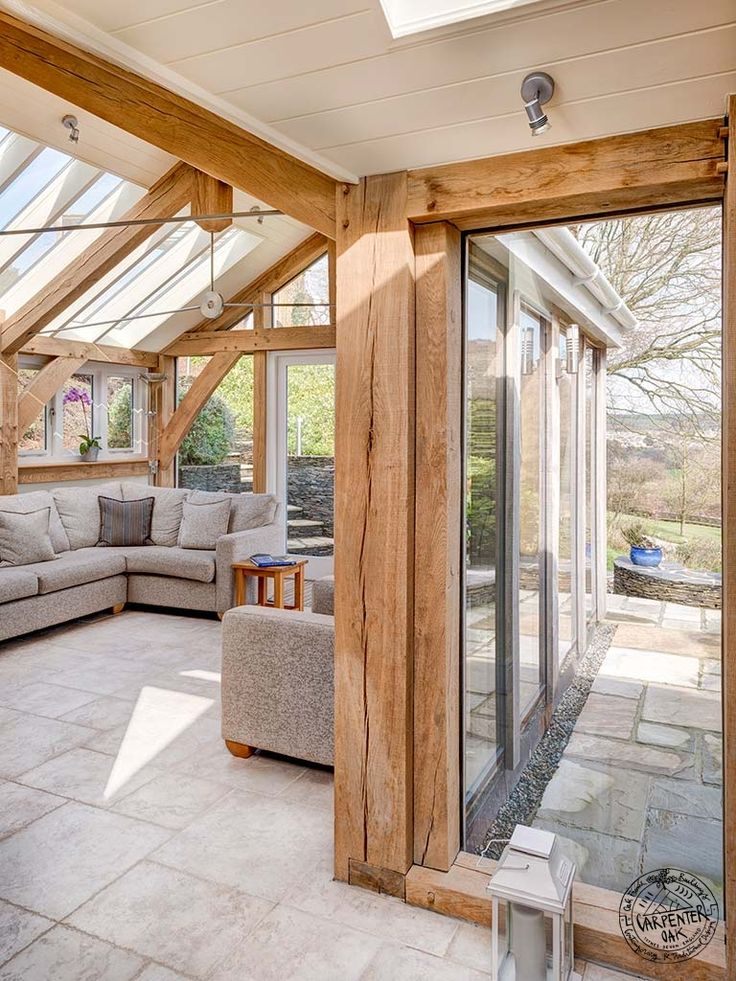 Light and Spacious Interior of Contemporary Green Oak Framed Extension in Devon by Carpenter Oak Ltd