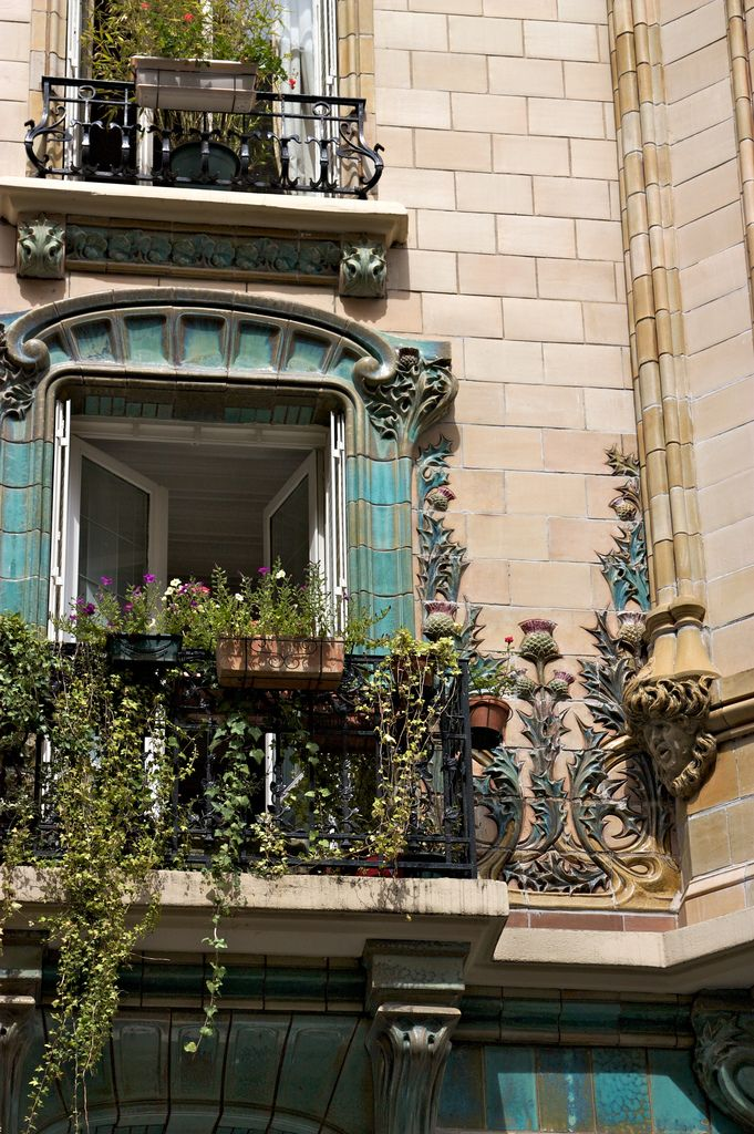 An Art Nouveau apartment; unique window details with thistle reliefs on the blue stone. - 2 rue Eugène Manuel, Paris