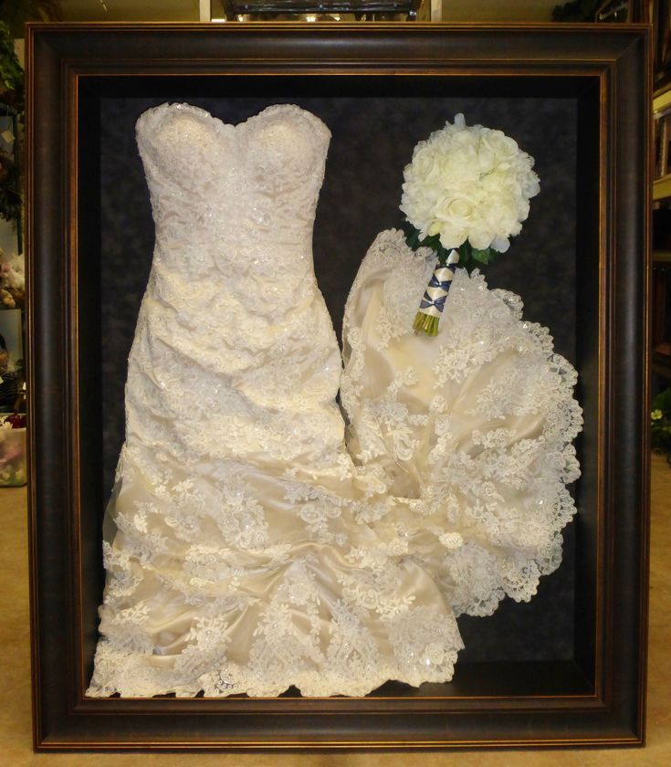Framed wedding dress and bouquet framed by Floral Keepsakes. This dress has been gathered up to fit in a smaller shadow box. www.facebook.com/FloralKeepsakesBoutique