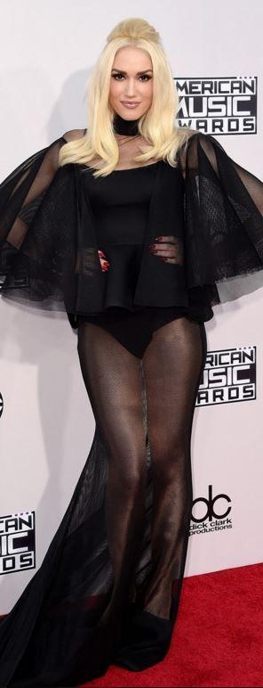 Who made  Gwen Stefani's black mesh gown?