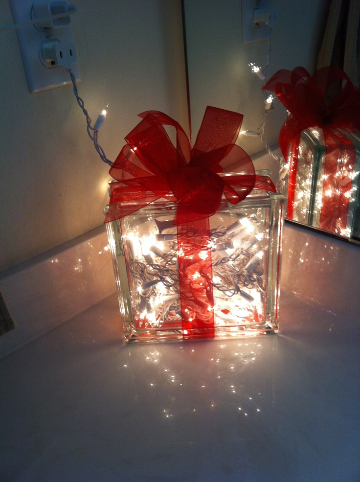 Christmas decorations ~~ so doing this one this winter!! NO DIY it's a glass window cube drilled and filled with lights. Don't forget the ribbon. :-)