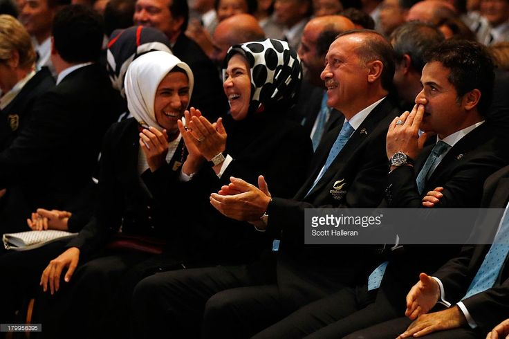 Prime Minister of Turkey, <a gi-track='captionPersonalityLinkClicked' href=/galleries/search?phrase=Recep+Tayyip+Erdogan&family=editorial&specificpeople=213890 ng-click='$event.stopPropagation()'>Recep Tayyip Erdogan</a> (C) and wife Emine (2L) and Turkey Minister of Youth and Sports, Suat Kilic (R) look on during the 125th IOC Session - 2020 Olympics Host City Announcement at Hilton Hotel on September 7, 2013 in Buenos Aires, Argentina.