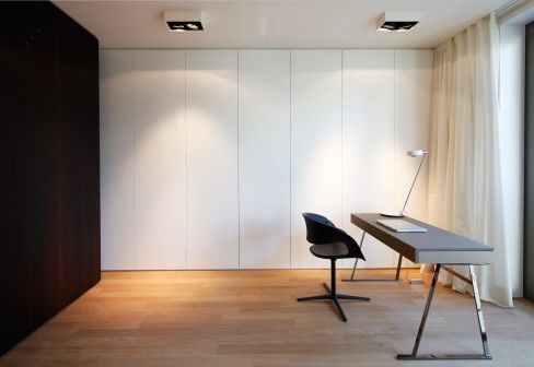 I think I'd like totally plain wardrobes painted the same as the walls to keep the room looking uncluttered