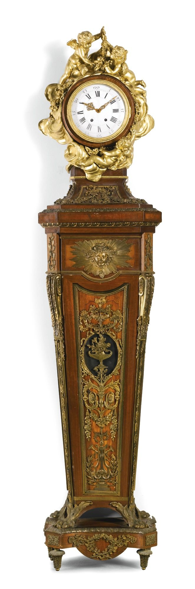 A Louis XVI-style gilt-mounted and kingwood inlaid mahogany pedestal clock after Jean-Henri Reisener, French, circa 1910 | Lot | Sotheby's