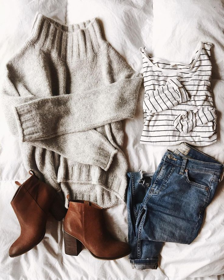 Oatmeal heather sweater, striped shirt, mid wash jean, and brown booties