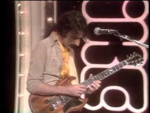 """Frank Zappa appearing on the Mike Douglas Show"" A surprising appearance on TV. And starts out with some pretty(?!?!) jazz-fusion. Santana-esque."