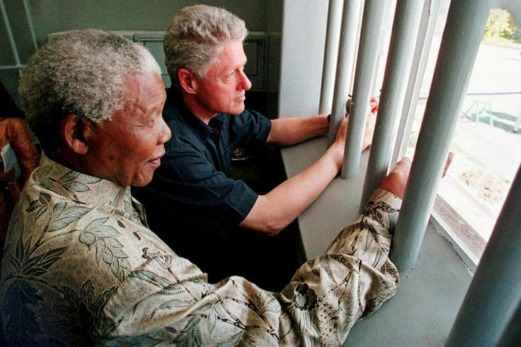 1998: Mandela spent 18 of his 27 years as a political prisioner on Robben Island. He took Bill Clinton, former US president, on a tour of the island's prison in 1998.