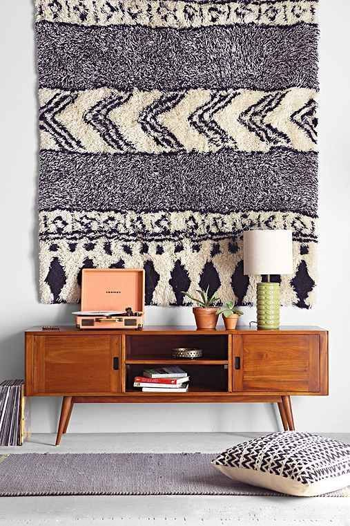 hang a precious rug on the wall instead of letting the thing get trampled on the floor.