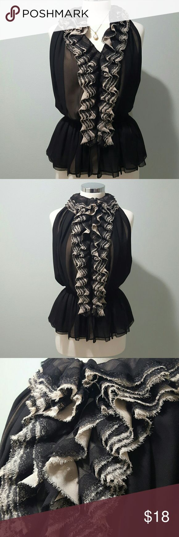 Fun and Flirty Niemen Marcus Top Ruffled chest with layers of black and cream. The neck can be left opened or buttoned up. Perfect condition. I imagine this top would be perfect with fitted jeans and heels. Smoke free home. Niemen marcus  Tops