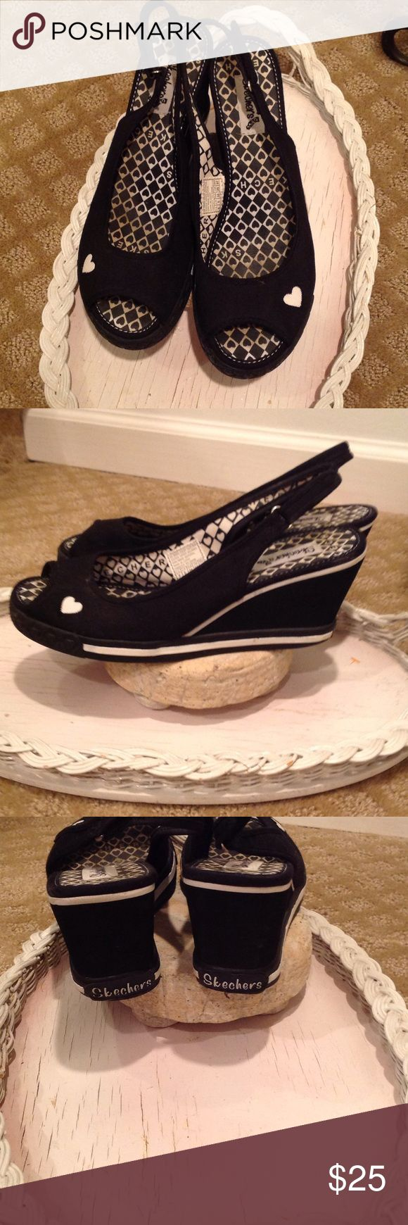 BLACK SKECHERS PEEP TOE WEDGES♥️ CUTE HEARTS ♥️ ON THESE SKECHERS WEDGES MAKE THE SHOE👍. GREAT WORN CONDITION. ADJUSTABLE STRAP. SO PERFECT FOR A DAY OUT♥️ Skechers Shoes Wedges