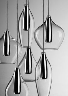 """Beautiful lighting fixtures - """"Tara Clear"""" lighting. TARA is a Suspension system with three or six diffusers in borosilicate blown glass with an inner satin glass concealing the 12V halogen lamp."""