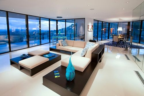 That is one amazing living room Open space minimal and huge