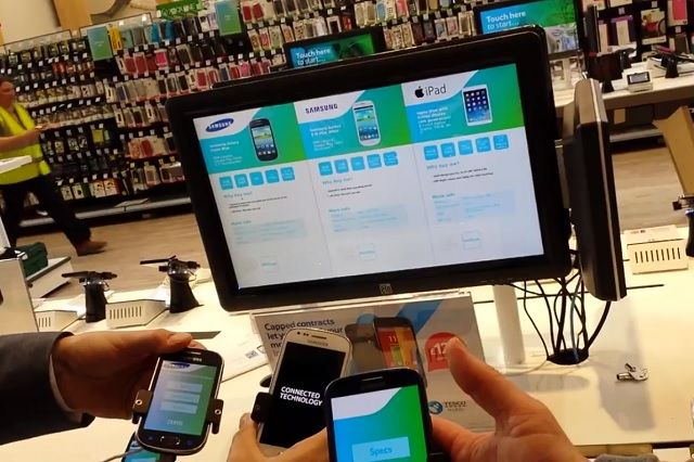 Pick up three phones and screen shows side by side comparison  http://retail-innovation.com/pick-up-three-phones-and-screen-shows-side-by-side-comparison/