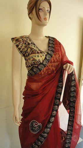 Red kota saree with kalamkari blouse
