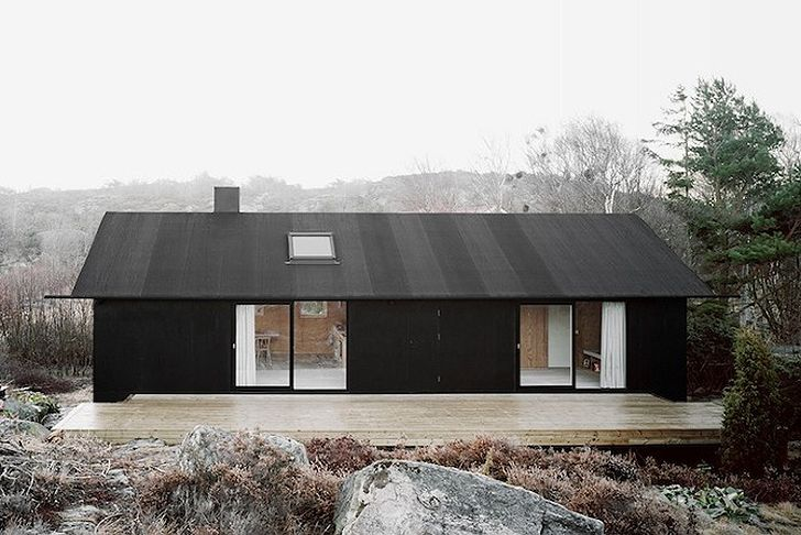 1950s Swedish Island Cottage Locks Out the Elements with a Black Pine Tar Facade