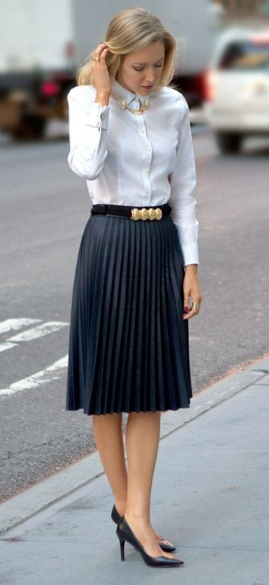 Pleated skirt and button down shirt.