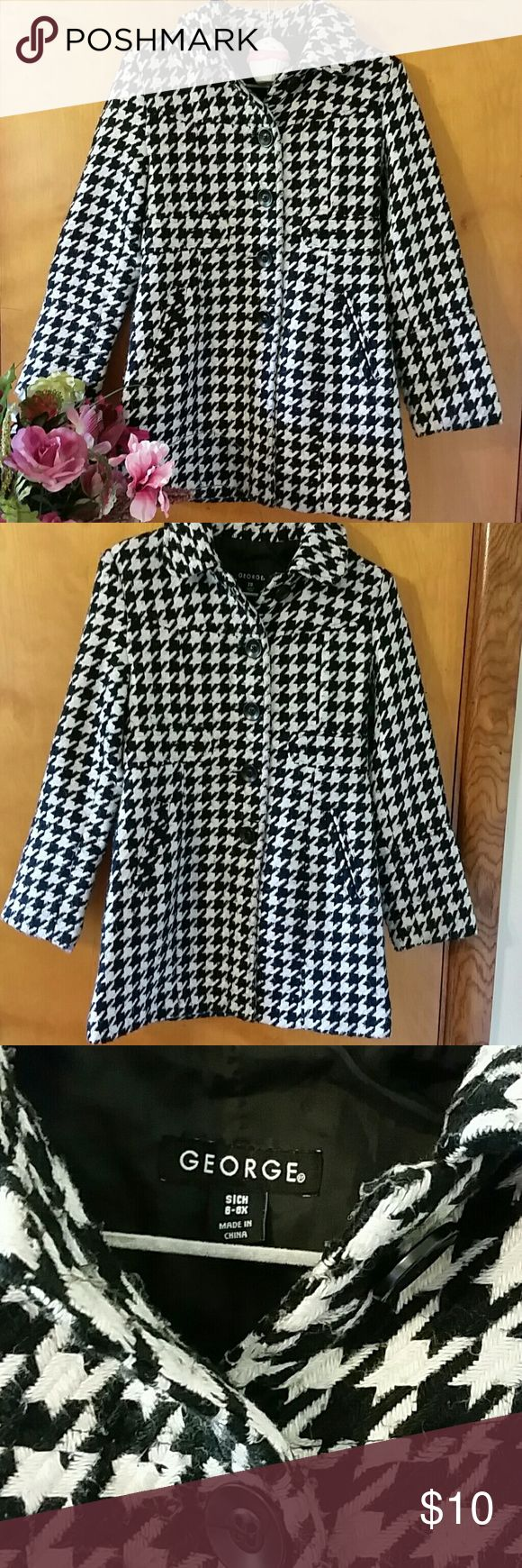 Girls Houndstooth Peacoat Houndstooth peacoat. George size 6-6X. Black buttons, side pockets, split in the back, fully lined.  Shows signs of wear, has a few loose threads on the back and some piling. 2 of my daughters used this as a dress coat over church dresses. Pre-loved but still in good condition. George Jackets & Coats Pea Coats