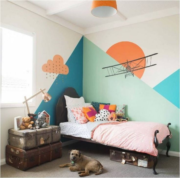 What a great wall design. Geometric with some wonderfun wall stickers. Simple bed and decor.