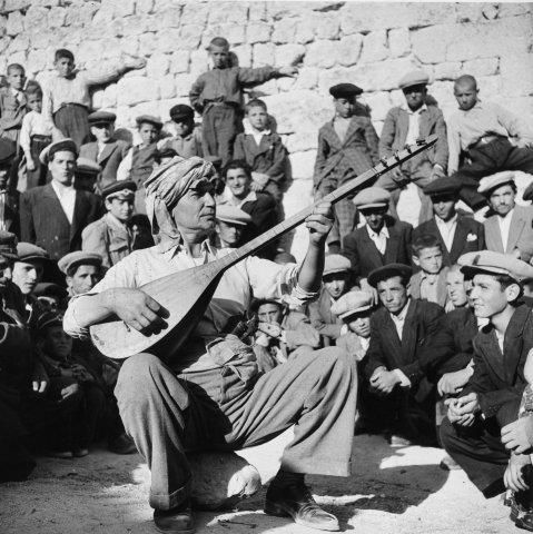 In the town of Urgup in Cappadoccia a townsman plays the Saz, Turkey's national instrument, which is like a lute