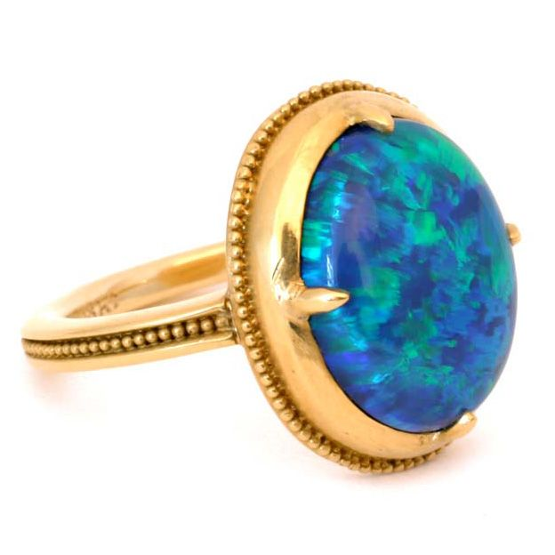 22kt Gold and Black Opal Ring. The ancient style of this ring's setting perfectly shows its exquisite 4.80 carat black opal; a stone of exceptional coloration and luminosity. Made in-house by Julius Cohen New York.