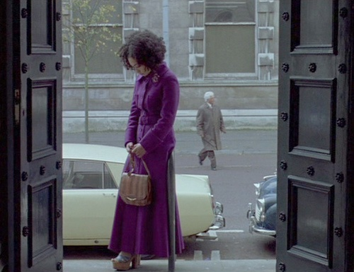 """How gorgeous is this purple coat? From """"Breakfast on Pluto""""."""