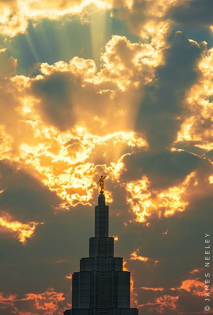 "Glory Beams - The statue of the Angel Moroni stands atop the Mormon Temple in Idaho Falls by James Neeley   ""...Walk as children of light...in all goodness and righteousness and truth."" Ephesians 5:8-9"