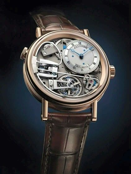 An example from Baselworld 2015 - it's a Breguet tradition minute repeater tourbillon - but huge on the self-aware side... a great time piece is elegant and it's function is the center of attention, not it's works.