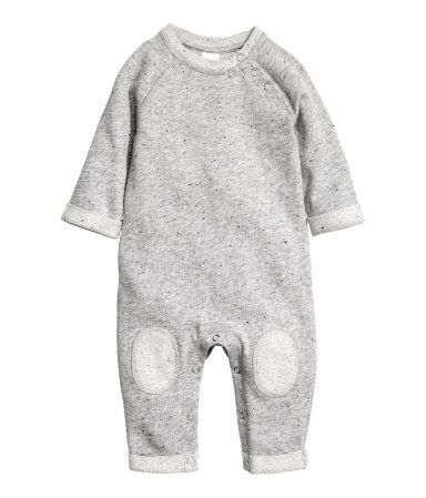 Gray melange. BABY EXCLUSIVE/CONSCIOUS. Jumpsuit in melange, organic cotton sweatshirt fabric with a nepped texture. Long raglan sleeves and long legs. Snap