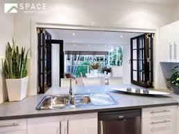 Sink is not centred in window space giving more area for breakfast bar and stacking plates etc.
