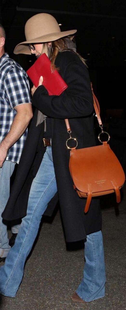 Who made Jennifer Aniston's tan hat and brown handbag?