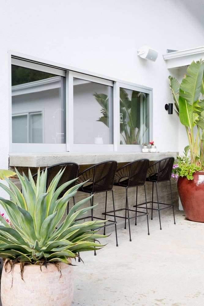Summer Style!! Excellent idea to add pass-through windows and a bar and bar stools from the kitchen to the deck, terrace veranda patio! Beautiful outdoor space