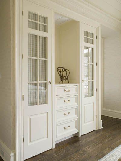 closets with a dresser & mirror between.