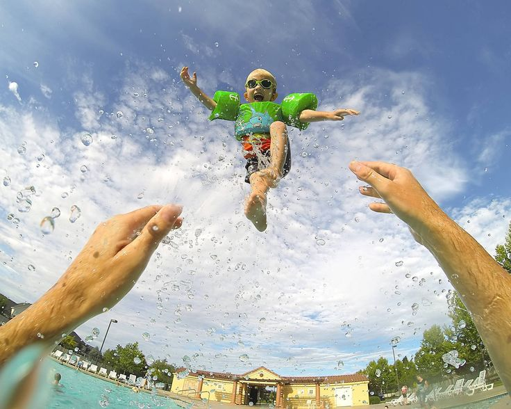 Up, up, and away! Scott McDaniel and his three year old at the pool. Get this shot - while keeping your hands free - with the GoPro Chesty: http://gopro.com/camera-mounts/chest-mount-harness