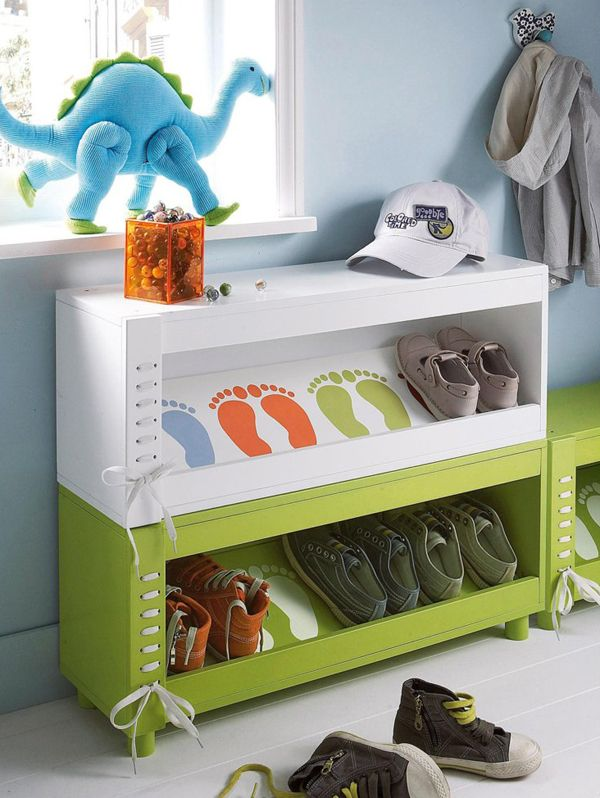 Unique shoe shelves with painted footprints in cool colors.