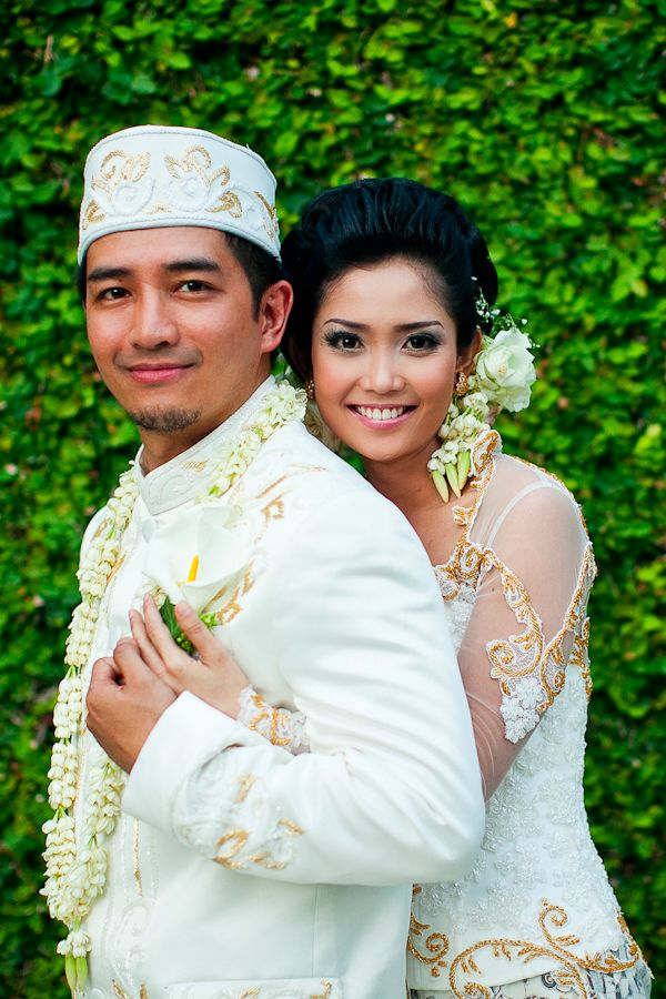 Beautiful bride and groom in traditional Indonesian attire.