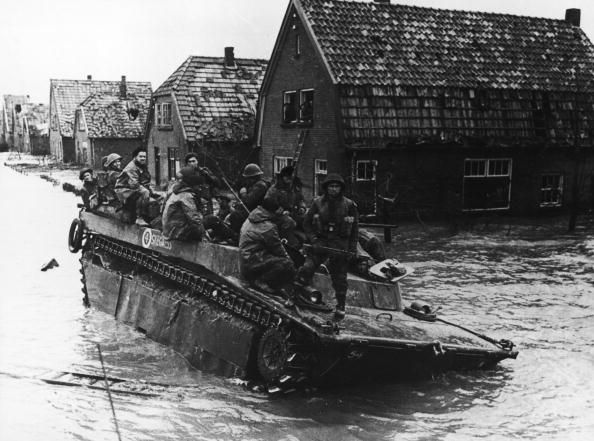 Canadian troops stranded on their amphibious vehicle east of Nijmegen by flooding wait to be rescued during World War II 1945 The flooding was caused...pin by Paolo Marzioli