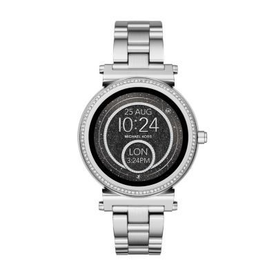 Michael Kors Access Sofie Stainless-Steel Touchscreen Smartwatch Powered by Android Wear™, the Michael Kors Access Sofie stainless-steel touchscreen smartwatch with full-round display and pavé crystal topring connects with your favorite apps and is compatible with iPhone® and Android™ devices. With built-in Google Assistant, you can use voice control to ask questions or give commands. Receive notifications, such as calls and alerts, at a glance as well. Fully personalize your watch by…