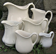 ironstone pitcher collection in different sizes. Collections have more of an impact when they are grouped together - note how these are facing the same way? Created harmony!