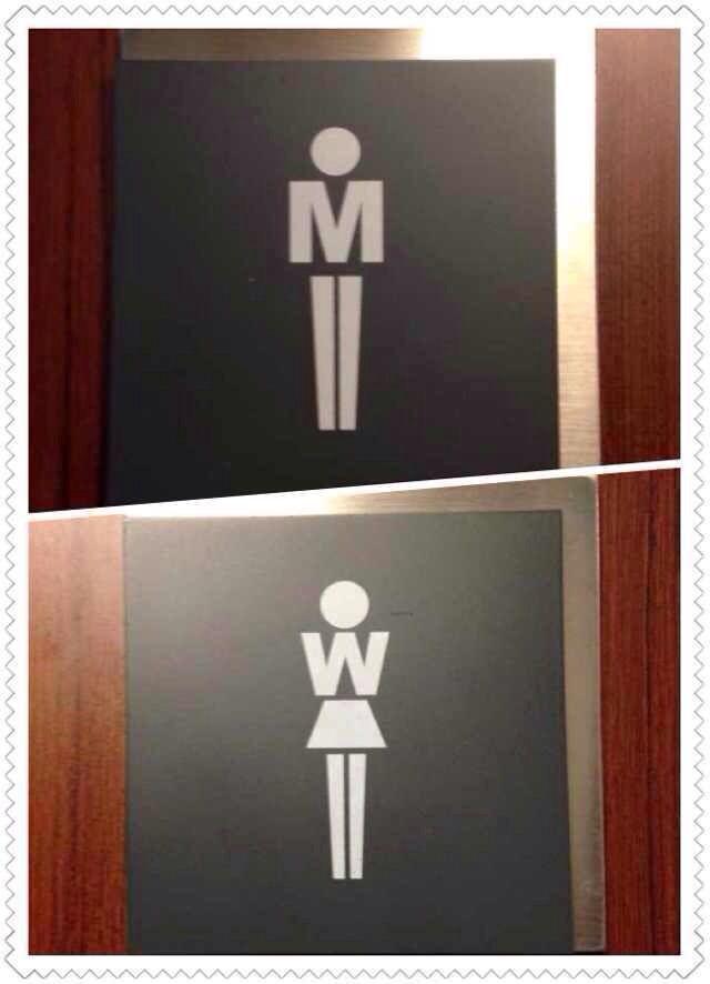 Signetique Logo-Mannfrau der Toilette