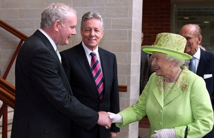 Historic moment: The Queen shakes hands with former IRA commander Martin McGuinness in front of Northern Ireland First Minister Peter Robins...