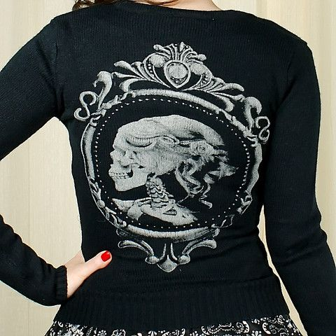 Skull Cameo Lolita Cardigan:Such a great basic for those cooler days! This is a long sleeve black cardigan that's a longer style with a grey skeleton lady cameo screen printed on the back. It's sure to go with all your outfits! 100percent acrylic, dry clean only. Size Bust Waist SM 32in 28in MED 34in 30in LG 36in 32in XL 38in 34in (Measurements taken... $40.00