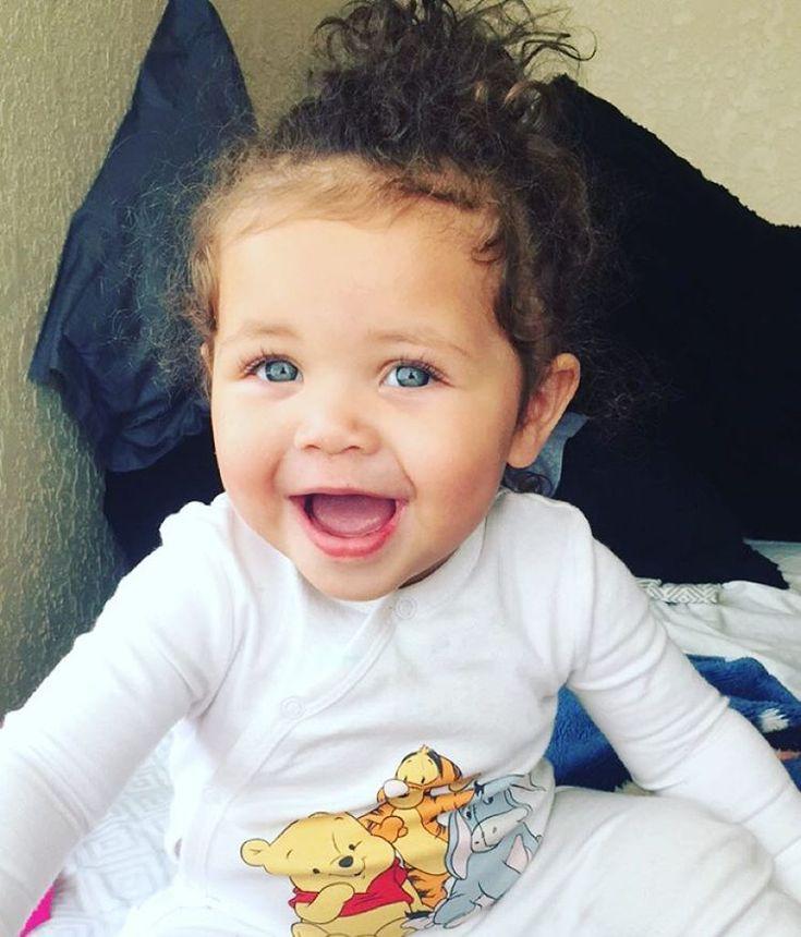 Gorgeous baby girl with amazing blue eyes