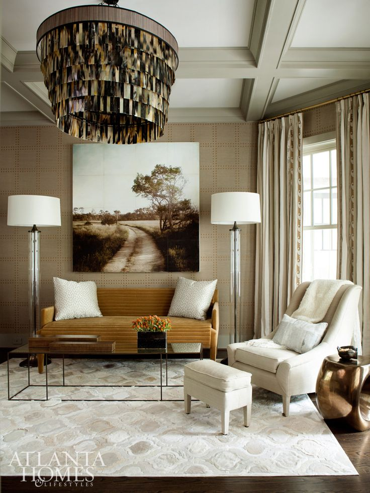 Neutral Living Room In Creams, Tans And Mustard With A Unique Modern  Chandelier, Tray Ceilings And Patterned Wallpaper.