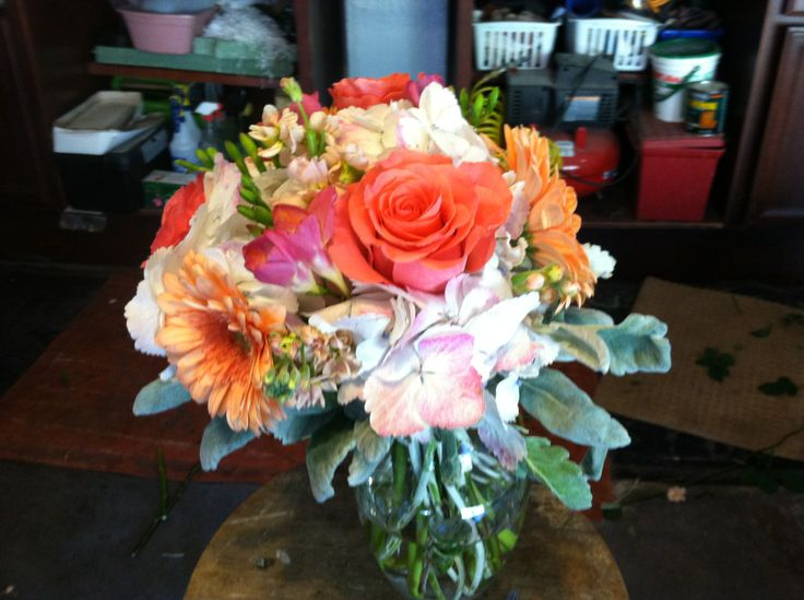 sample bouquet that I did this weekend with orange roses and gerbers -- the hydrangea I used was white but would use green for yours