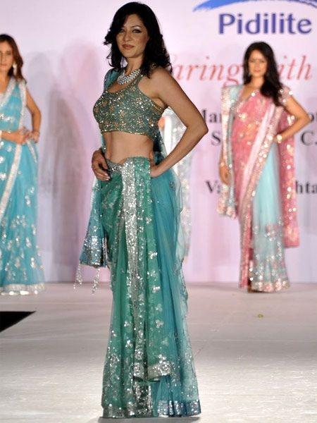 Model, doctor and ex-Mrs World Aditi Govitrikar looks lovely in an aqua blue sari by Shaina NC