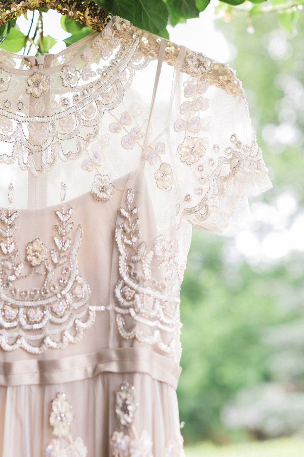 embellished wedding gown - photo by Alexis June Weddings http://ruffledblog.com/london-inspired-jewel-tone-shoot #weddingdress