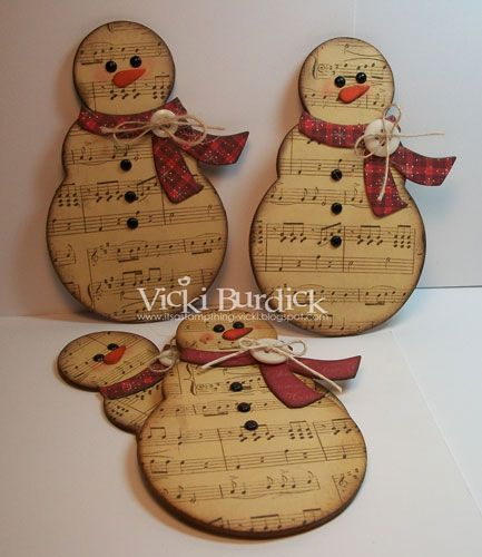 rustic snowmen made of music sheets, red homespun scarf, button and twine, these guys need hats but they are SO CUTE!!! Love it!