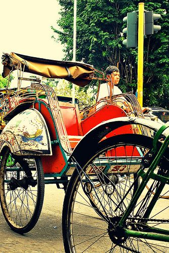 becak.  a traditional three-wheeled cart. yogyakarta, indonesia.
